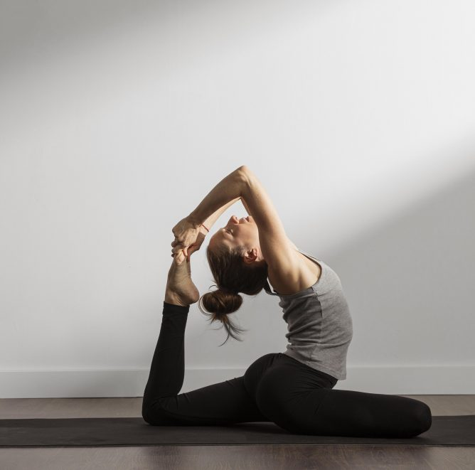 active-woman-practicing-yoga-at-home