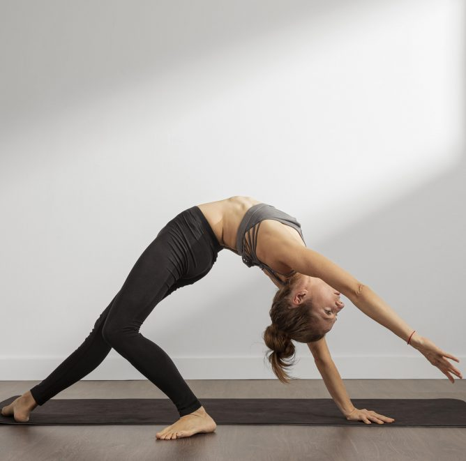 adult-woman-doing-yoga-at-home