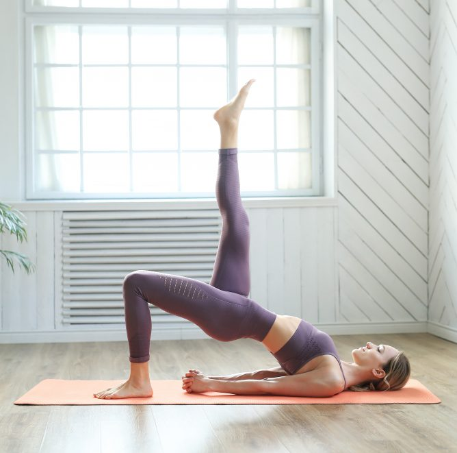Lifestyle. Woman practicing yoga at home